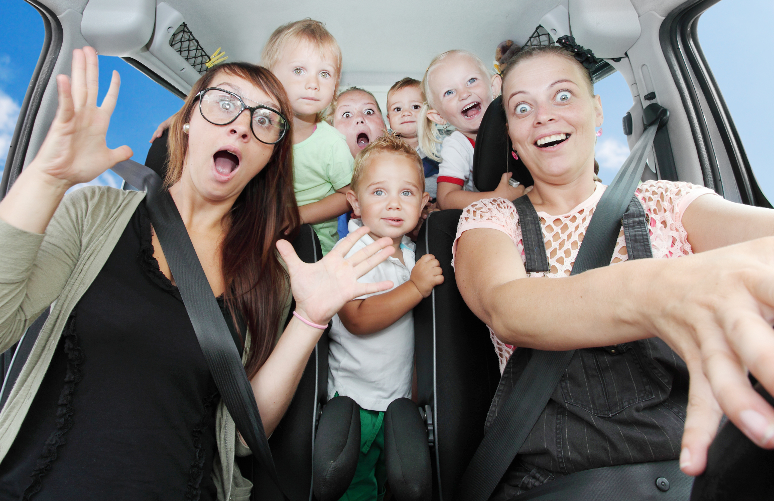 Crazy mothers with her children riding to holidays.